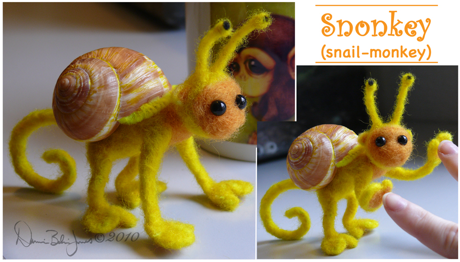 felted wool doll with snail shell